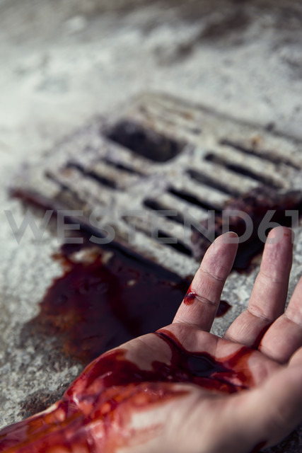 Blood-stained hand at gully - MID000064