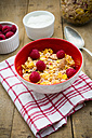 Bowl of glutenfree cereals with fresh raspberries and natural yoghurt - LVF002825