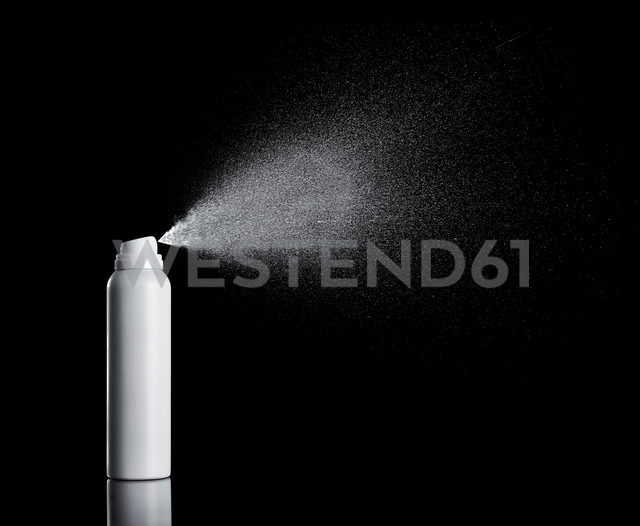 White spraying aerosol can in front of black background - RAMF000047