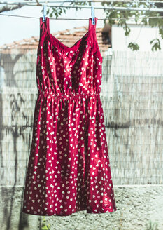 Bulgaria, red dress with heart shapes on laundry - DEGF000122
