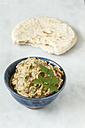 Bowl of Baba Ghanoush with flat bread - EVGF001104