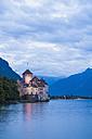 Switzerland, Veytaux, Lake Geneva, Chillon Castle at dusk - WDF002873