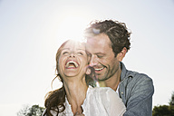 Laughing couple at backlight - PDF000790