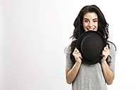 Portrait of smiling young woman with bowler hat - GDF000690
