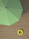 Green sunshade and yellow floating tire on wooden terrace, 3D Rendering - UWF000378