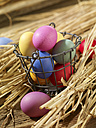 Multicolored Easter eggs on straw - SRSF000577
