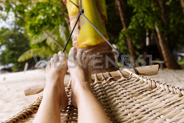 Philippines, Palawan, woman's feet in a hammock near El Nido - GEMF000053