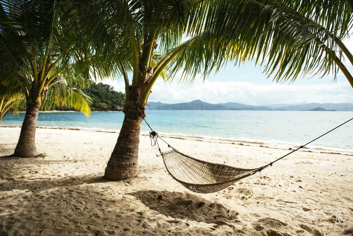 Philippines, Palawan, hammock and palms on a beach near El Nido - GEMF000049 - Gemma Ferrando/Westend61