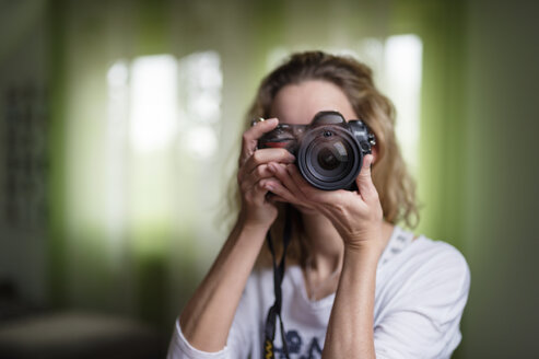 Woman taking a photo with her camera - FRF000198