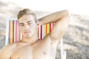 Thoughtful young man on beach chair - ZEF004619