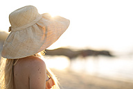 Young woman wearing summer hat on the beach - ZEF004628