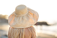 Young woman wearing summer hat on the beach - ZEF004629