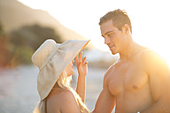 Young couple talking on the beach - ZEF004631