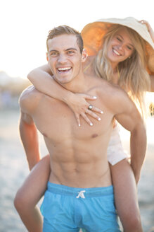 Carefree young couple on the beach - ZEF004633
