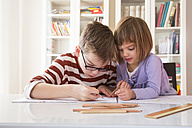 Brother and sister drawing together - LVF002889