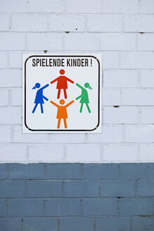 Germany, Aachen, sign playing children - HL000838