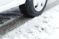 Germany, Bavaria, car tire in snow, close-up - MAEF009800