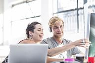 Creative office people having fun at desk - ZEF003091