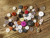Collection of different buttons on wood - SRSF000578