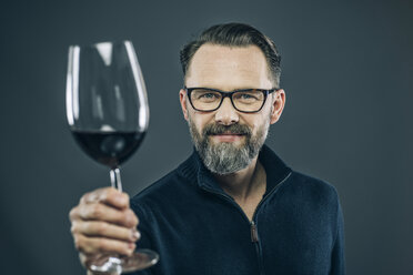 Man offering glass of red wine - IPF000199