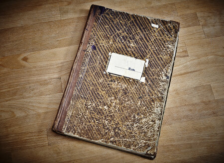 Old notebook on wooden table - RHF000632