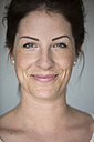 Portrait of smiling woman with freckles - SHKF000259