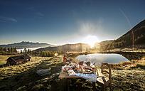 Austria, Salzburg State, Altenmarkt-Zauchensee, alpine pasture, breakfast at sunrise - HHF005108