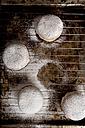Bismarck doughnuts on baking grid - CSTF000880
