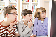 Boy and his two sisters spending time at computer - LVF002933