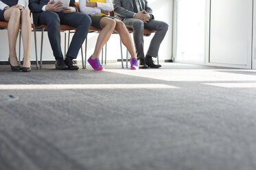 People sitting in a row, waiting for job interview - WESTF020942