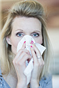Blond woman blowing nose - CHPF000082