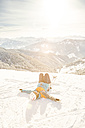 Austria, Salzburg State, Hochkoenig Region, female skier lying in snow - DISF001411