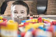 Boy with his building bricks on a table - DEGF000376