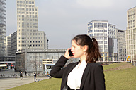 Germany, Berlin, Potsdamer Platz, businesswoman on smartphone - BFRF000948
