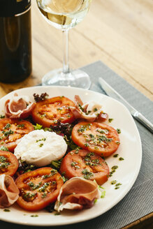 Tomato mozzarella salad served in a restaurant - AKNF000007