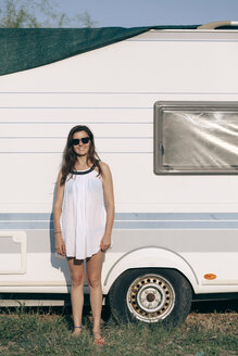 Young woman wearing summer clothes In front of caravan - BZF000052