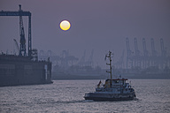 Germany, Hamburg, sunset at container harbor - HLF000840