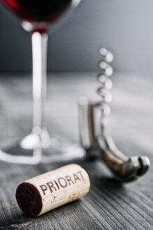 Glass of red wine, corkscrew and wine cork with the word 'Priorat' - IPF000207