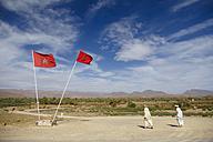 Morocco, two men near Moroccan flags - STD000143