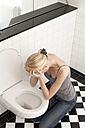 Despaired anorexic young woman at the toilet - DRF001537