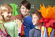 Happy pupils with school cones at blackboard - MFRF000073
