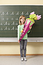 Happy girl with school cone at blackboard - MFRF000076