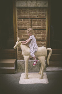 Little girl riding on a horse figure - GS000980