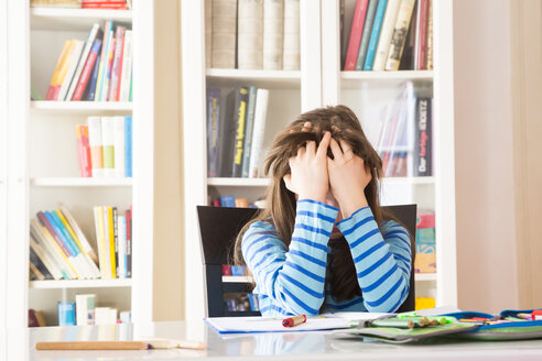 Frustrated girl doing homework - LVF002963