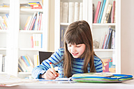 Girl doing homework - LVF002970