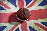 Chocolate muffins on chopping board with English flag - CSF024758
