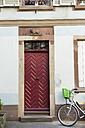 France, Strasbourg, La Petite France, red old entry door - JUN000247