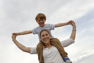 Little boy sitting on shoulders of his mother - LBF001078