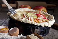 Raw apple pie in cake pan and ingredients - CSF024777