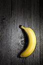 Banana on grey wood - CSF024846